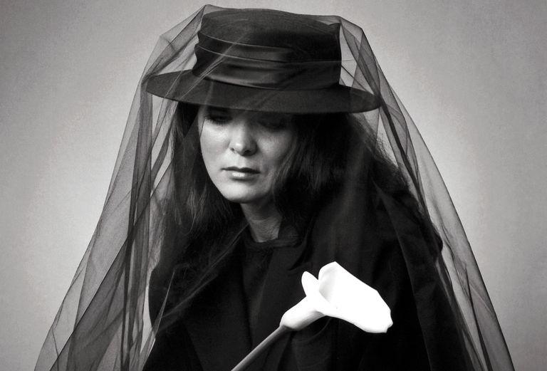Grieving woman wearing veil