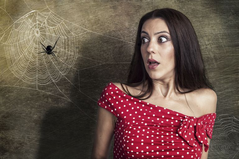 woman frightened by a spider
