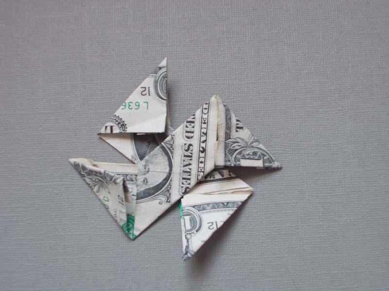 how to make a dollar bill origami ninja star