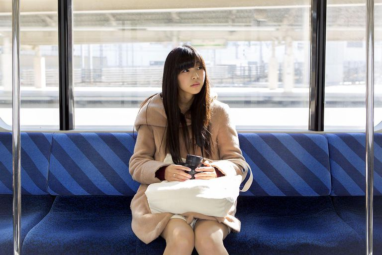 Asian Girl with Camera Sitting in Train