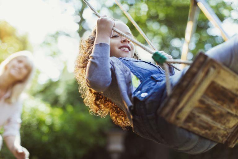 Carefree girl swinging in park