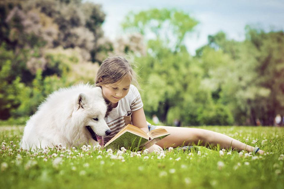 Girl reading to her dog