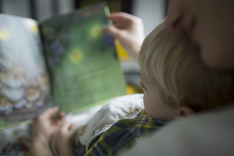 Close up mother and son reading book