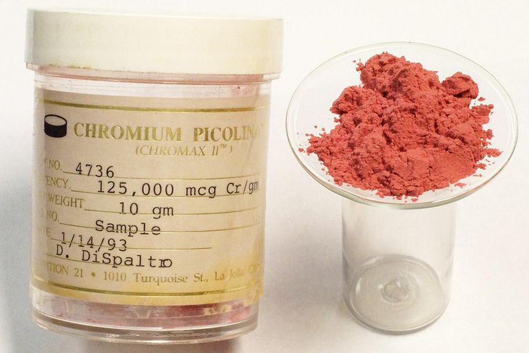 "Watchglass holds two grams of ""Chromax II"" pure chromium picolinate powder from NUTRITION 21, originally supplied to be used in a rodent feeding experiment in 1993. The substance is a reddish crystalline powder, very sparingly soluble in water. It is 12.5% chromium (III) by weight."