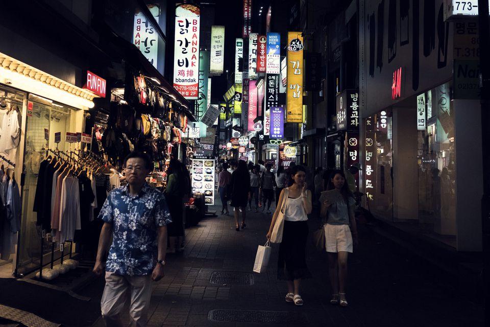 People at Myeongdong Shopping Street at night