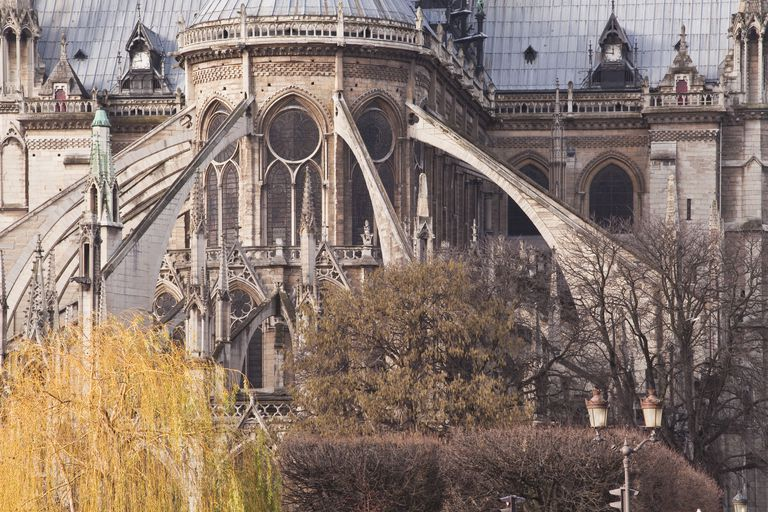 The flying buttress, characteristic of Gothic architecture, on Notre Dame  de Paris cathedral