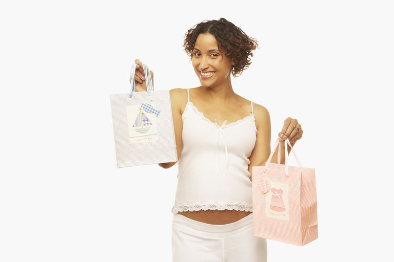 Pregnant woman with pink and blue shopping bags