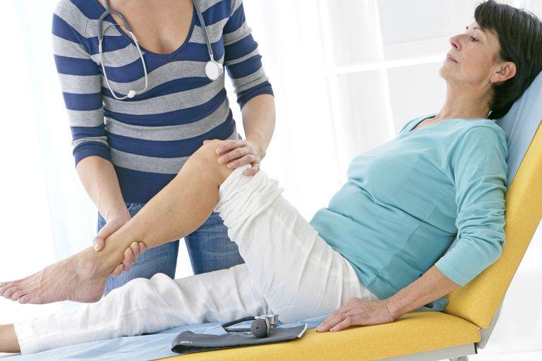 Woman having knee examined.