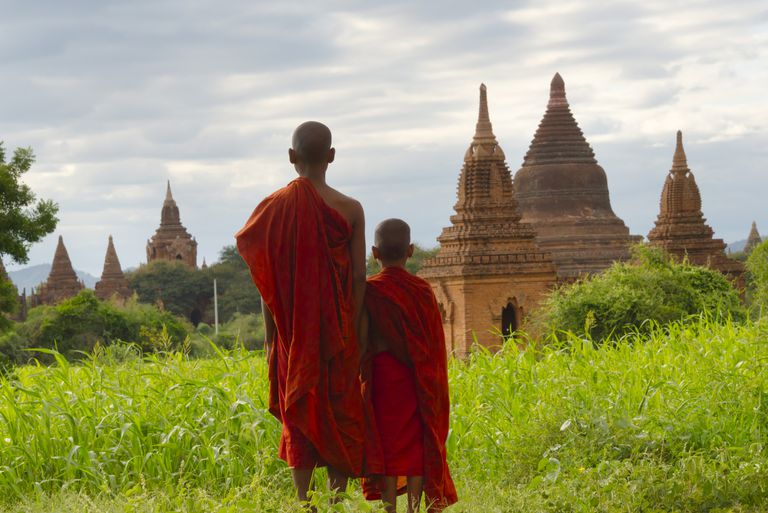 Buddhist Monks View Stupas