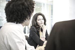 Woman firing an employee with a witness