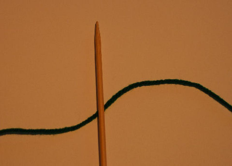 Knitting needle and black yarn