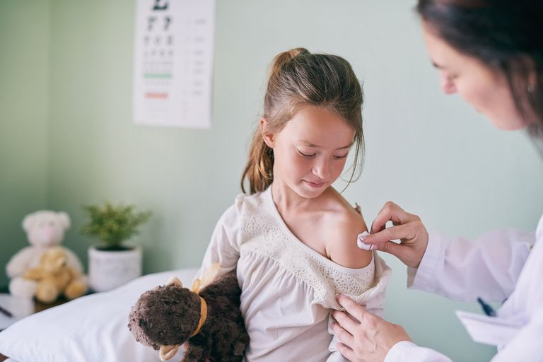 Girl getting vaccine at the doctor