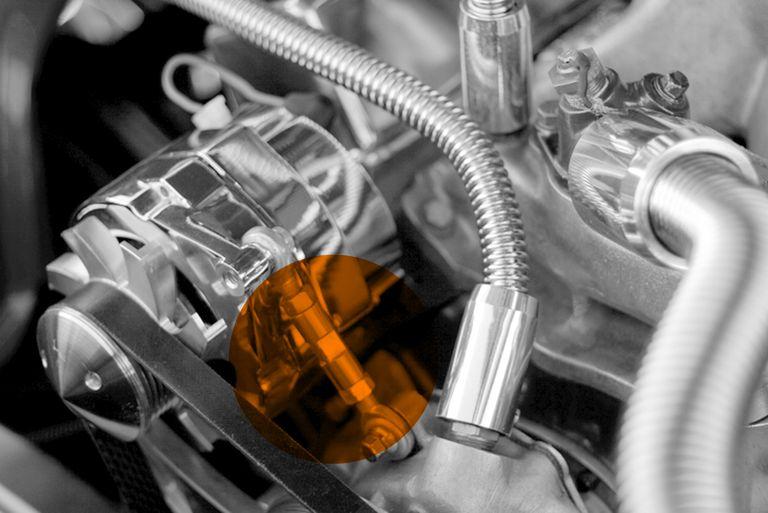 mechanical belt tensioner mounted on an alternator on a custom engine