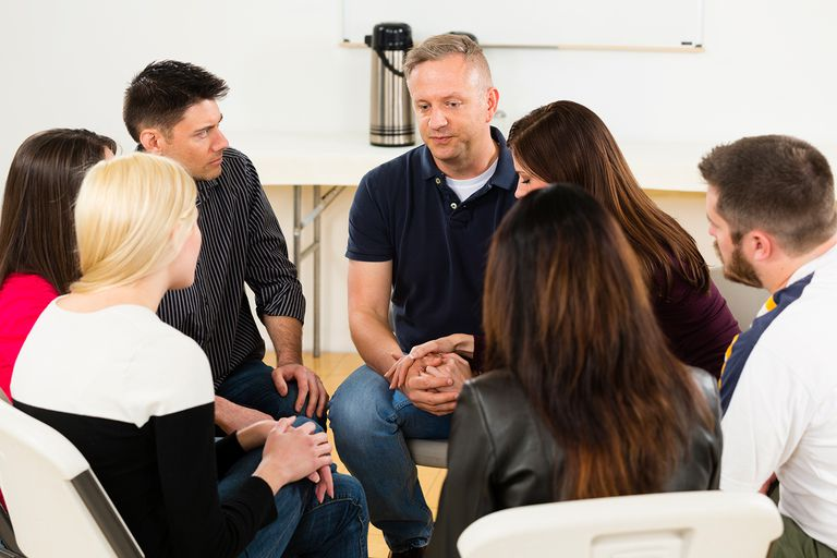 A man sharing his emotions in a support group.