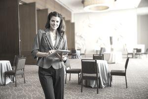 an event planner standing in a ballroom