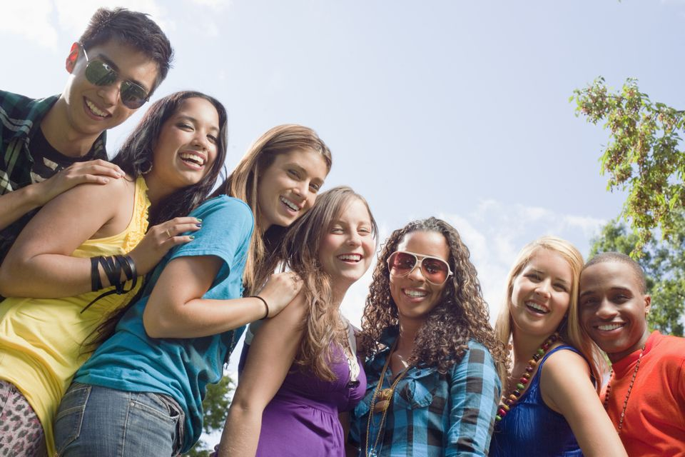 Group of smiling teenage girls and boys