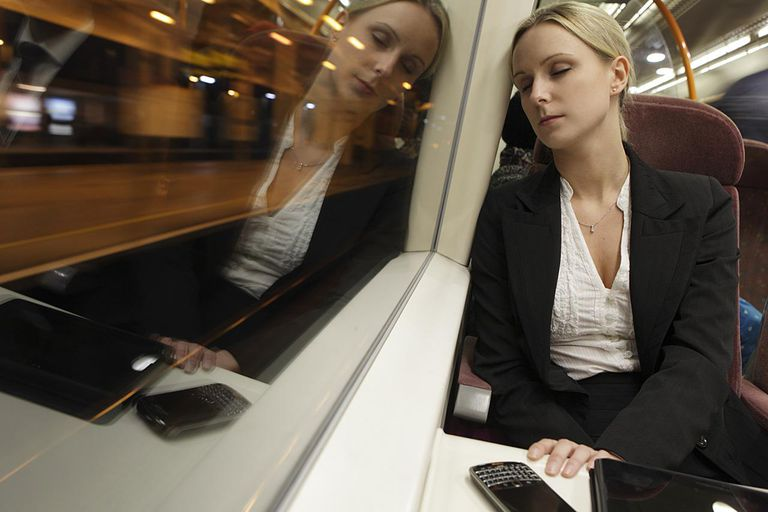 Female executive asleep on train