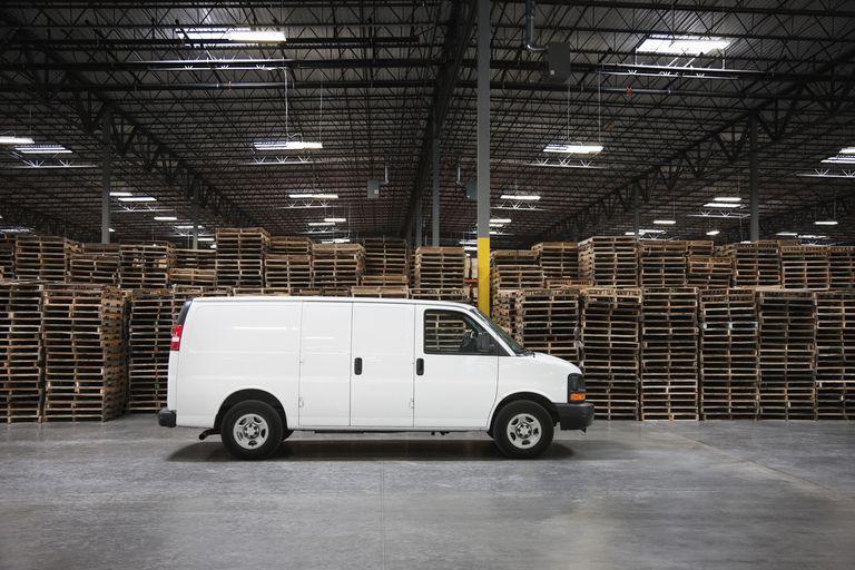 Cargo van parked in an empty warehouse