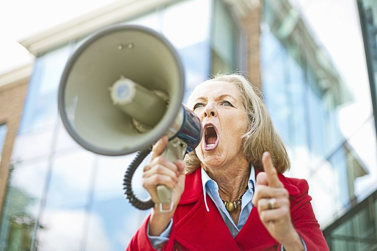 Older woman shouting into megaphone