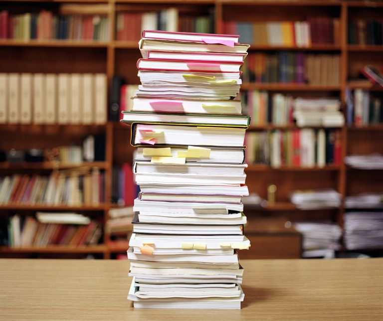 A stack of books on management