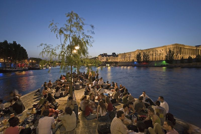 Picnicking on the banks of the River Seine is a favorite summer pasttime.