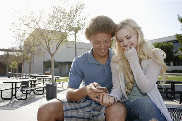 Couple looking at cell phone