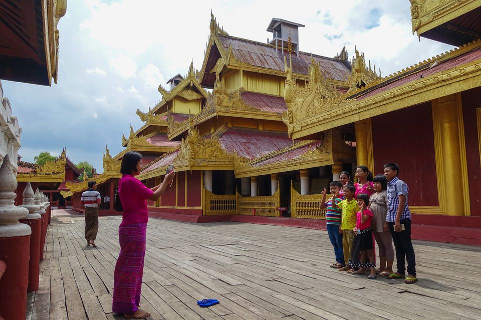 Family posing for pictures at Mandalay Palace, Myanmar