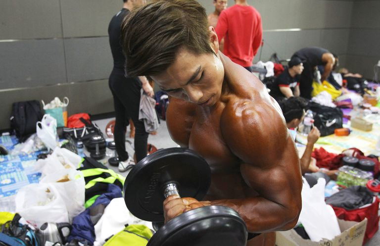 Body builder doing a bicep curl