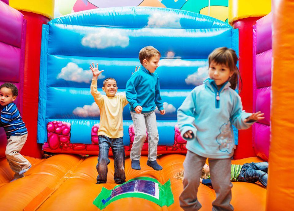 Kids enjoying in bouncy castle.