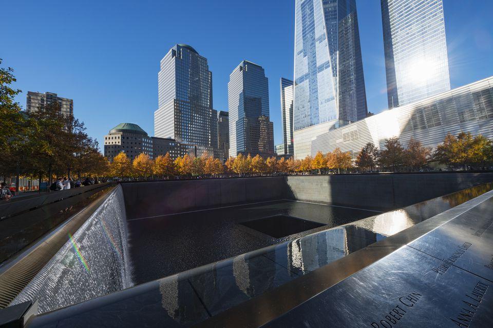 Illuminateed autumn trees and skyscrapers at 9/11