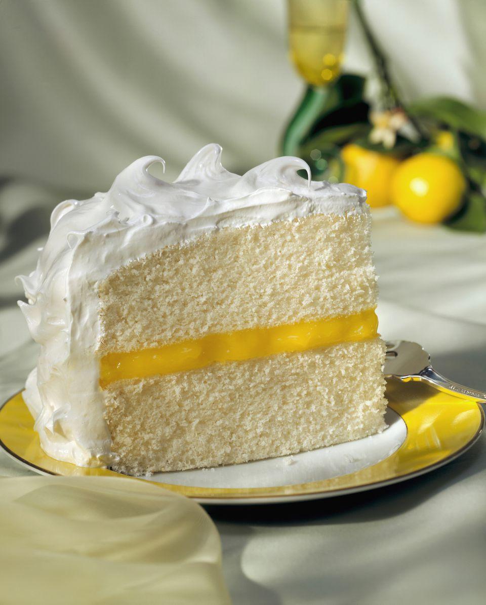 Piece of sponge cake with lemon cream and meringue