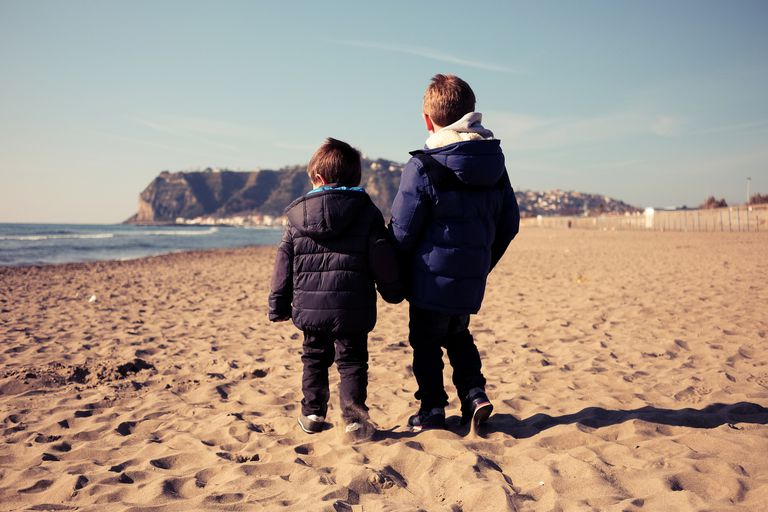Rear View Of Children On Beach