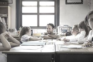 Teacher Helping Students at Desks in Classroom : Stock Photo View similar imagesMore from this photographerDownload comp Teacher Helping Students at Desks in Classroom