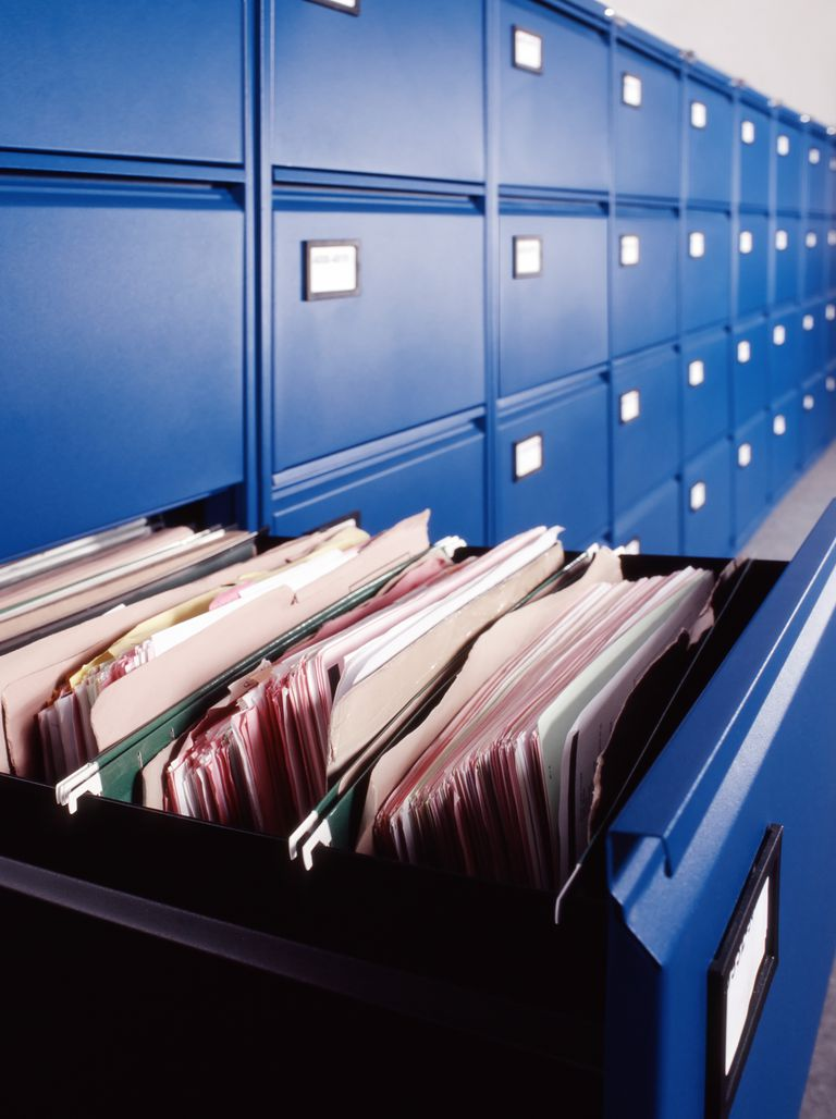 Picture of blue filing cabinets with one open drawer
