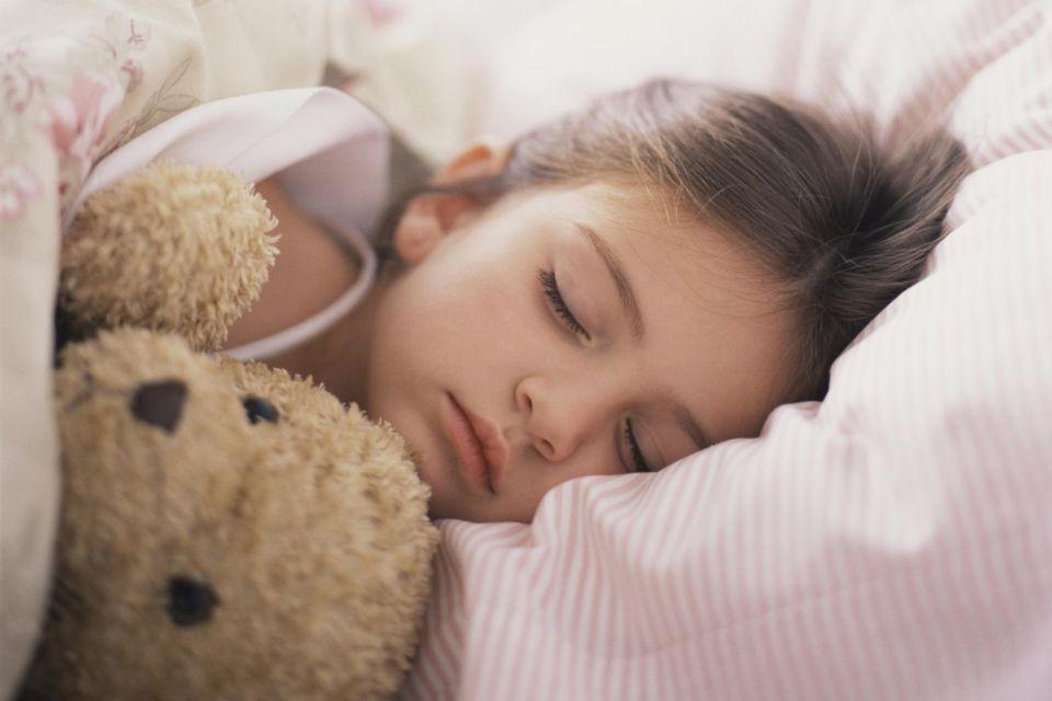 Girl with teddy bear sleeping