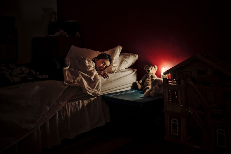A child asleep with a nightlight.