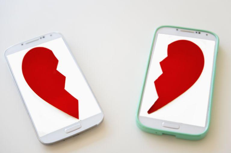 Smart phones with broken heart on screen