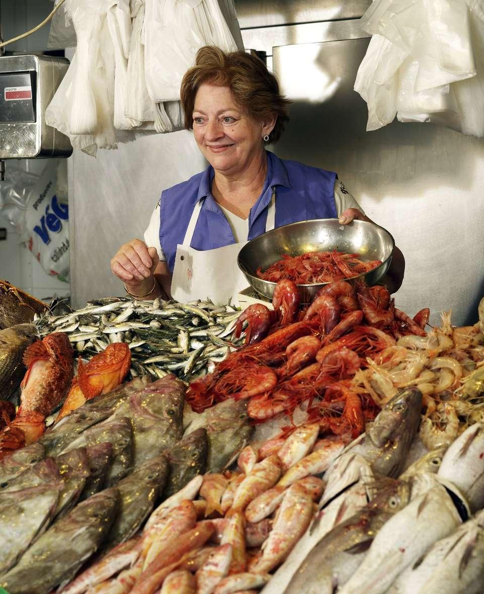 Woman sells fish at stand