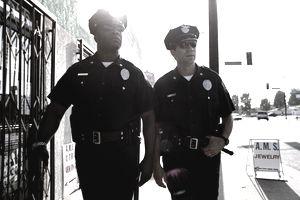 Two policemen walking down the sidewalk