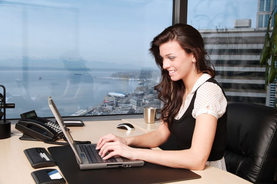 Woman on a computer at her desk