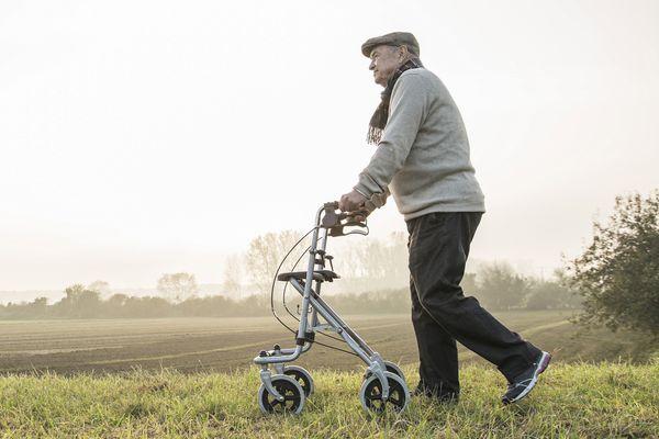 A man using a rollator.