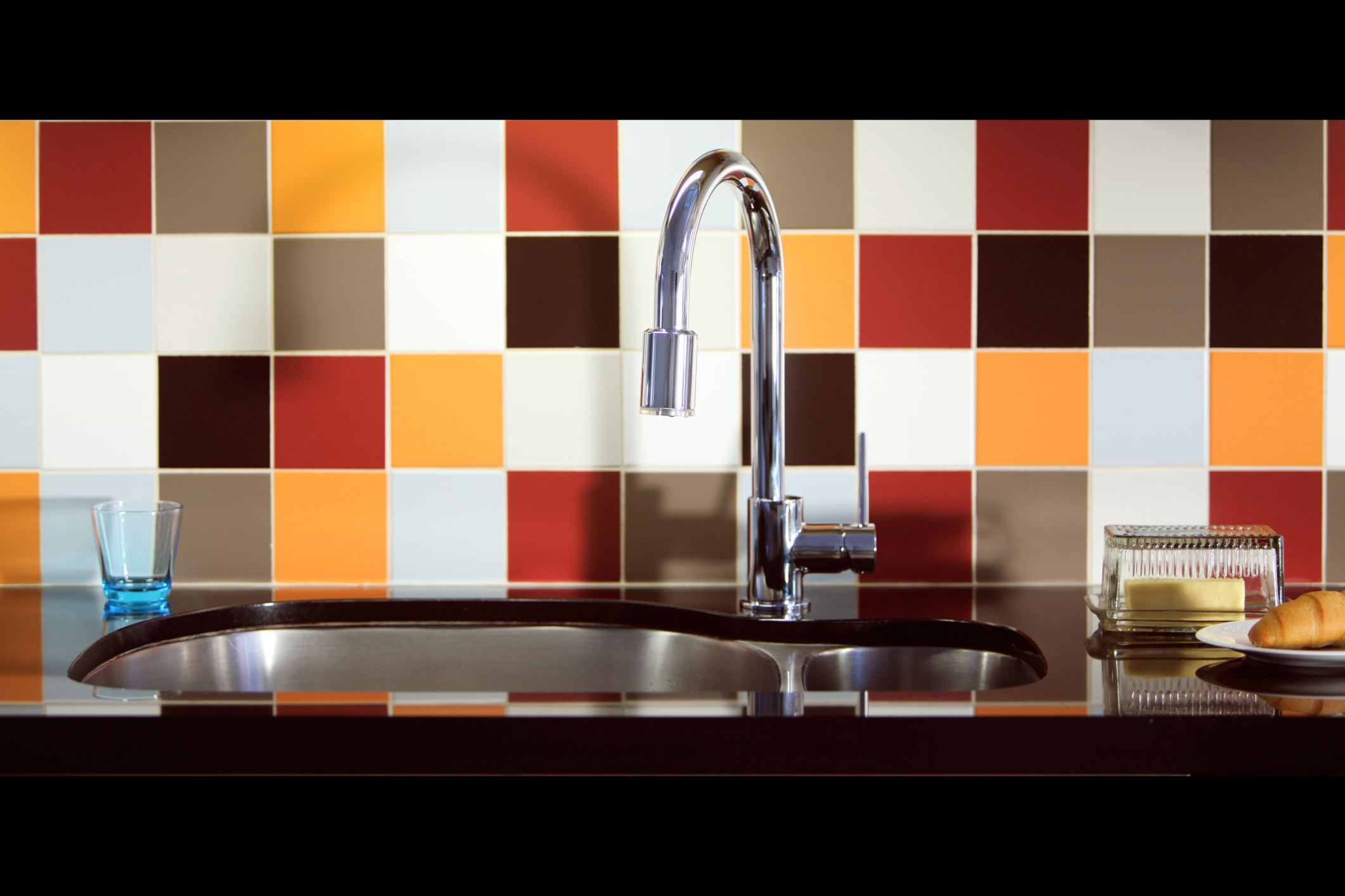 Multi Colored Tile Backsplash Behind Sink in Kitchen 56a49fdf3df78cf fec
