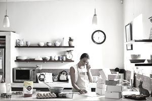 Woman taking order for cupcakes