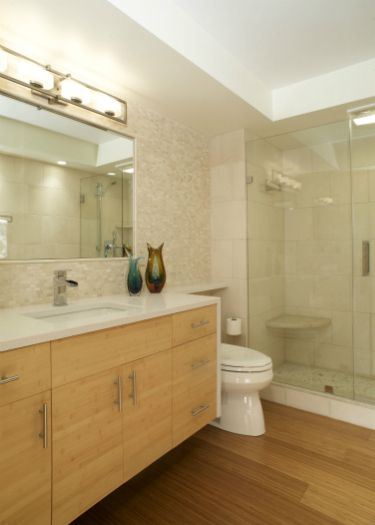 Modern bath with bamboo floor designed by Jeff Rizzi, Reico Kitchen & Bath.