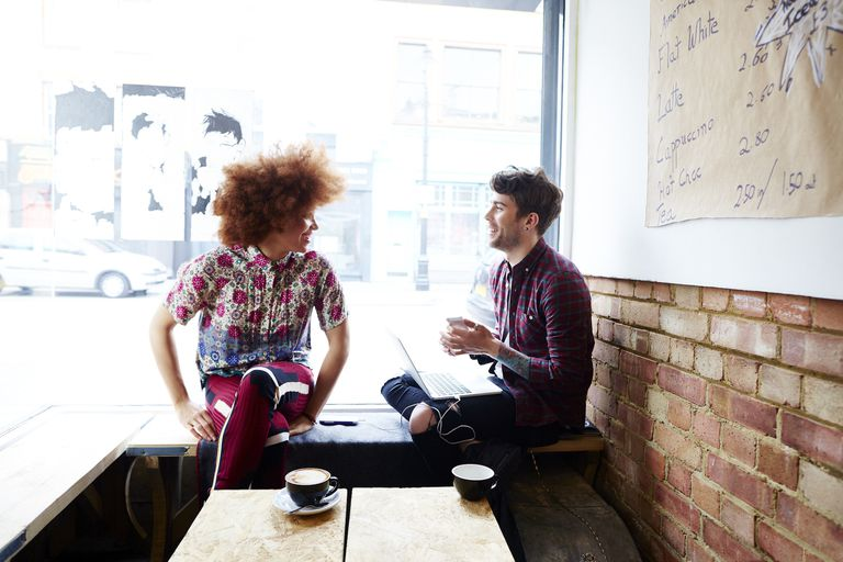 Two friends chatting in a coffee shop