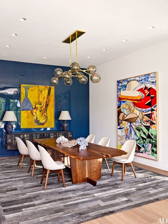 Blue And Gray Dining Room Filled With Art