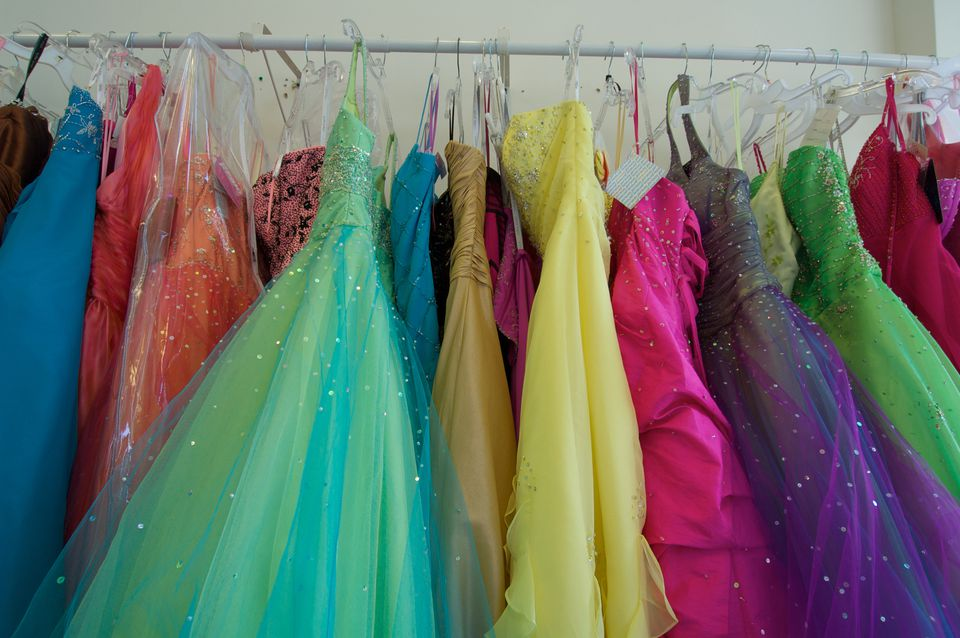 Pretty prom dresses ready for young shoppers crowd the rack.