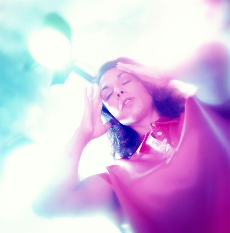 Woman experiencing vertigo.