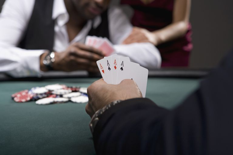 Man with four aces in casino