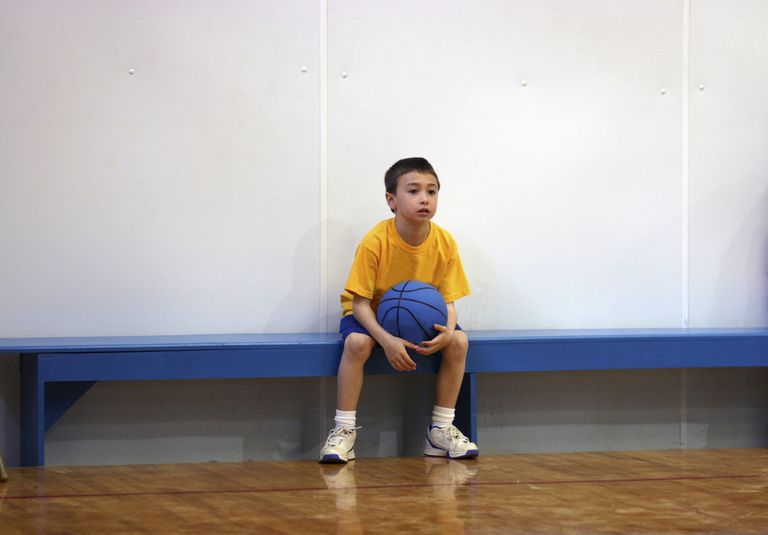 Performance anxiety in children - boy on bench in gym
